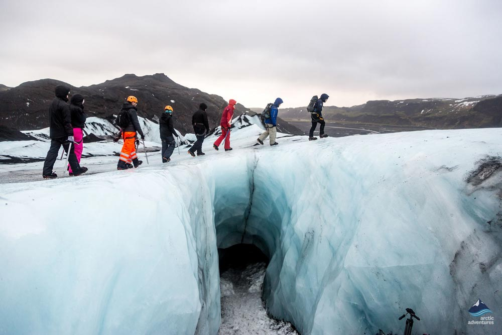 Travelers glacier hiking on solheimajokull with arctic adventures