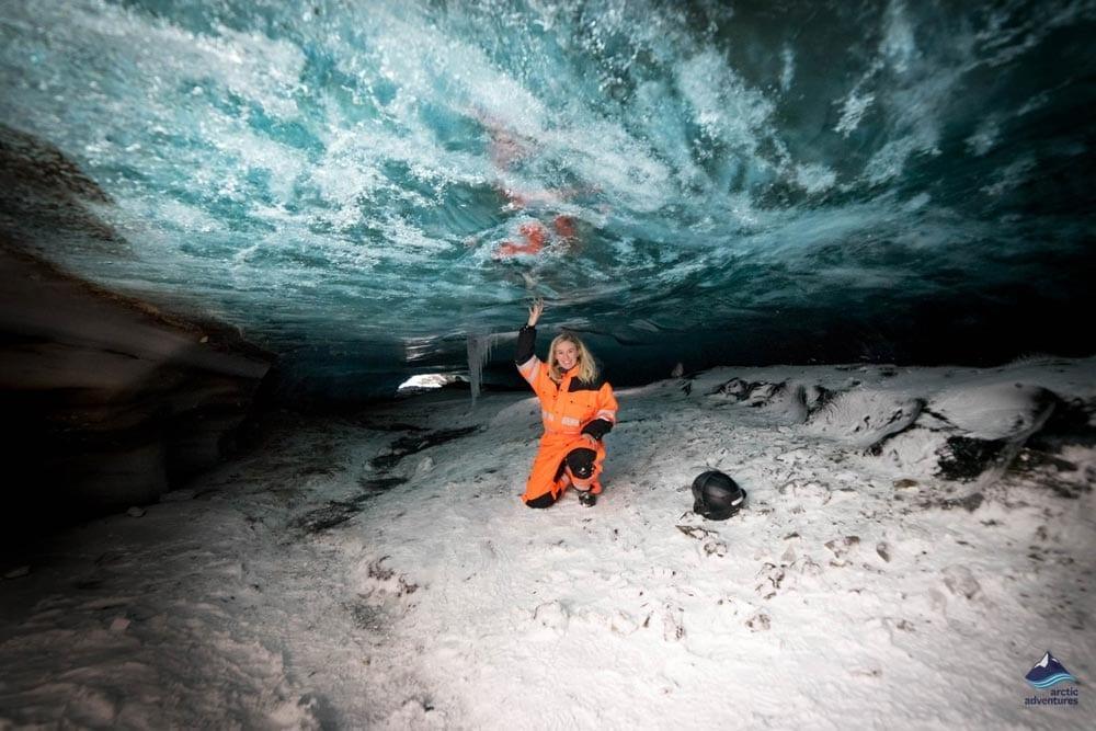 Sitting inside a glacier ice cave in Langjokull glacier