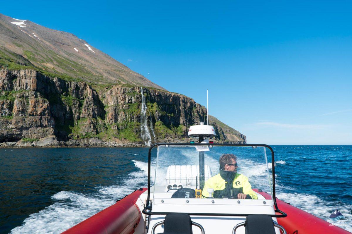 Man driving a rib boat