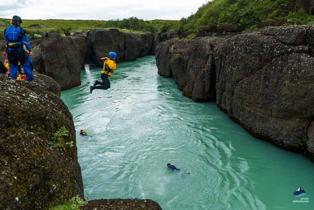 Jumping into the Gullfoss river in Iceland
