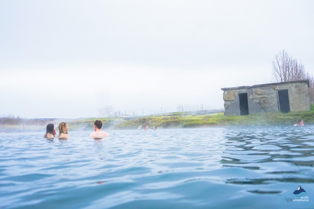 bathing in gamla laugin at fludir iceland