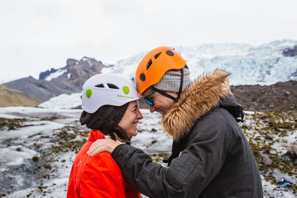 A couple in love on the glacier hiking tour on Falljokull glacier
