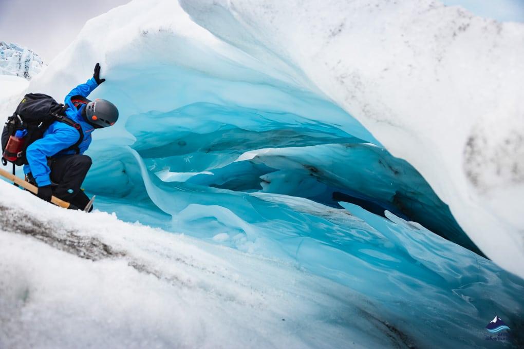 Hiker exploring glacier