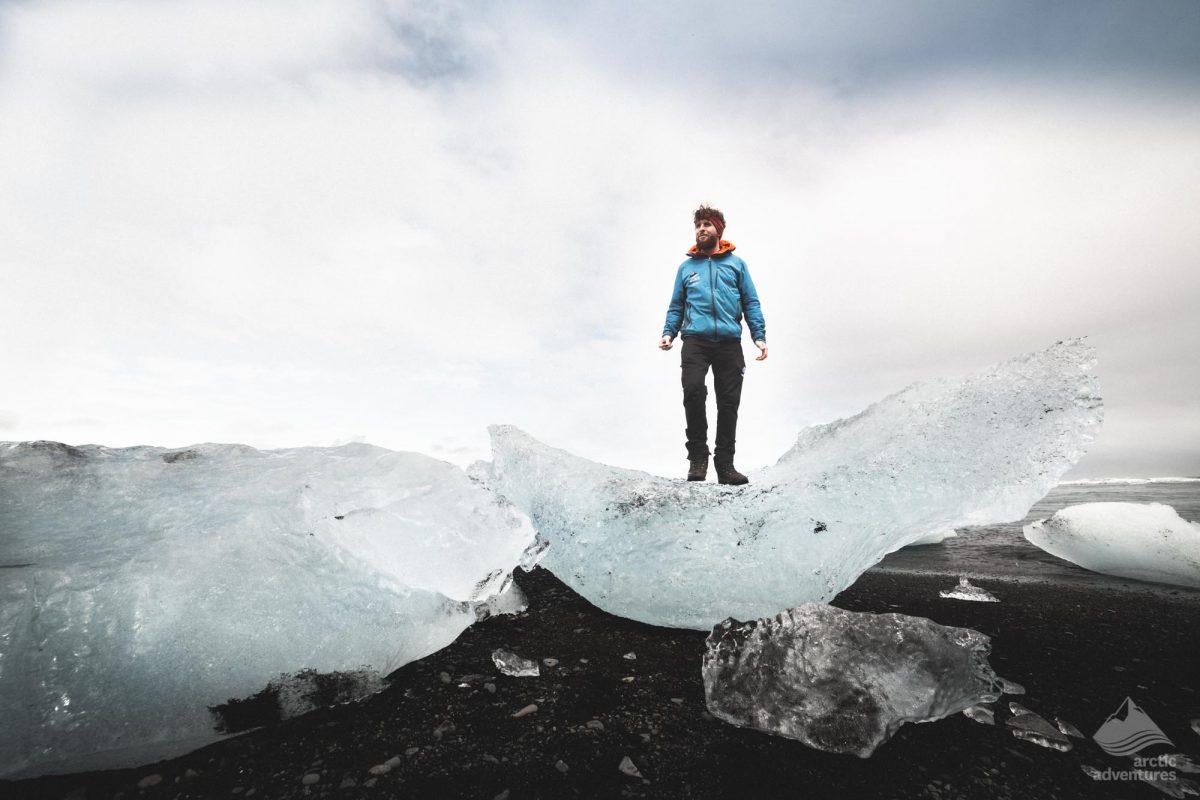 Man on Iceberg at diamond beach iceland