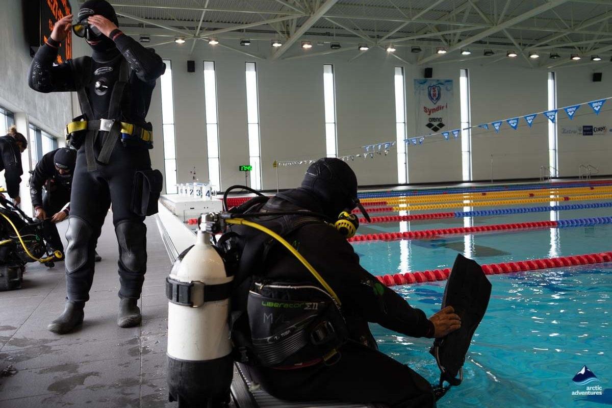 preparing for pool dive