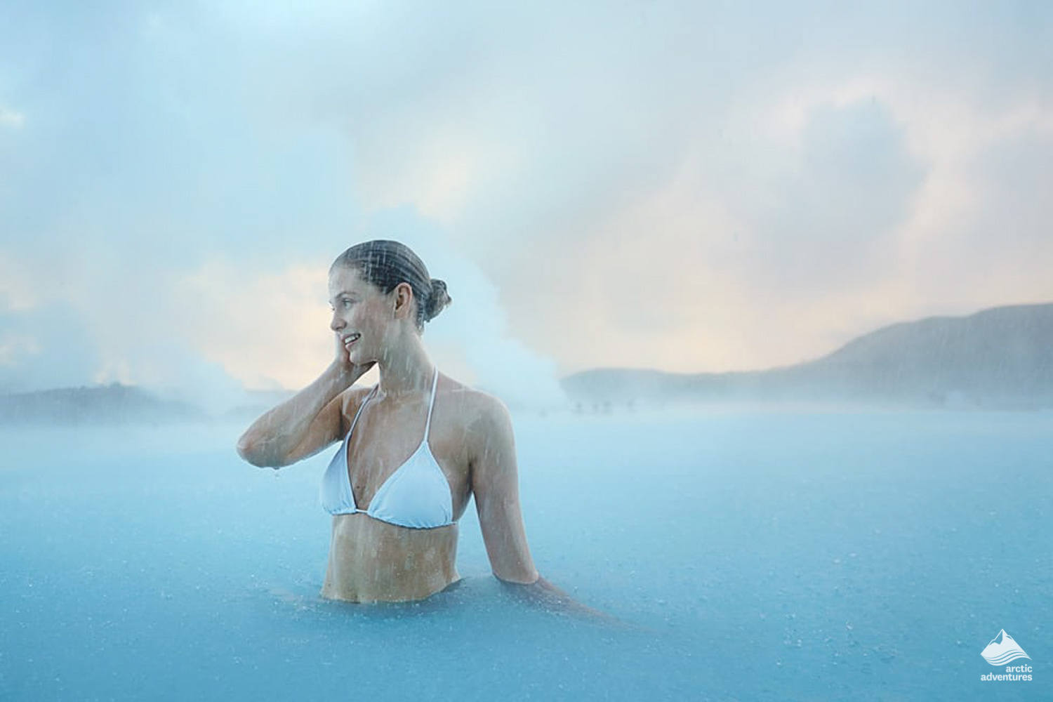 Woman soaking in the Blue Lagoon