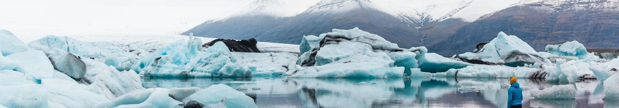 cyan blue ice bergs floating on a lagoon