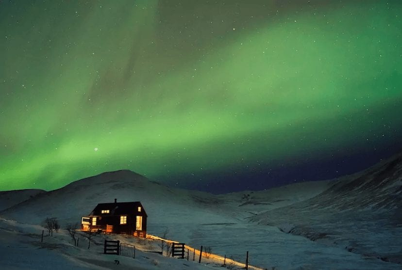 Budardalur Remote Cabin bathing in Northern Lights