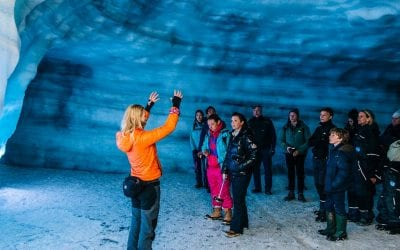 People in the man-made Ice Cave in Langjökull