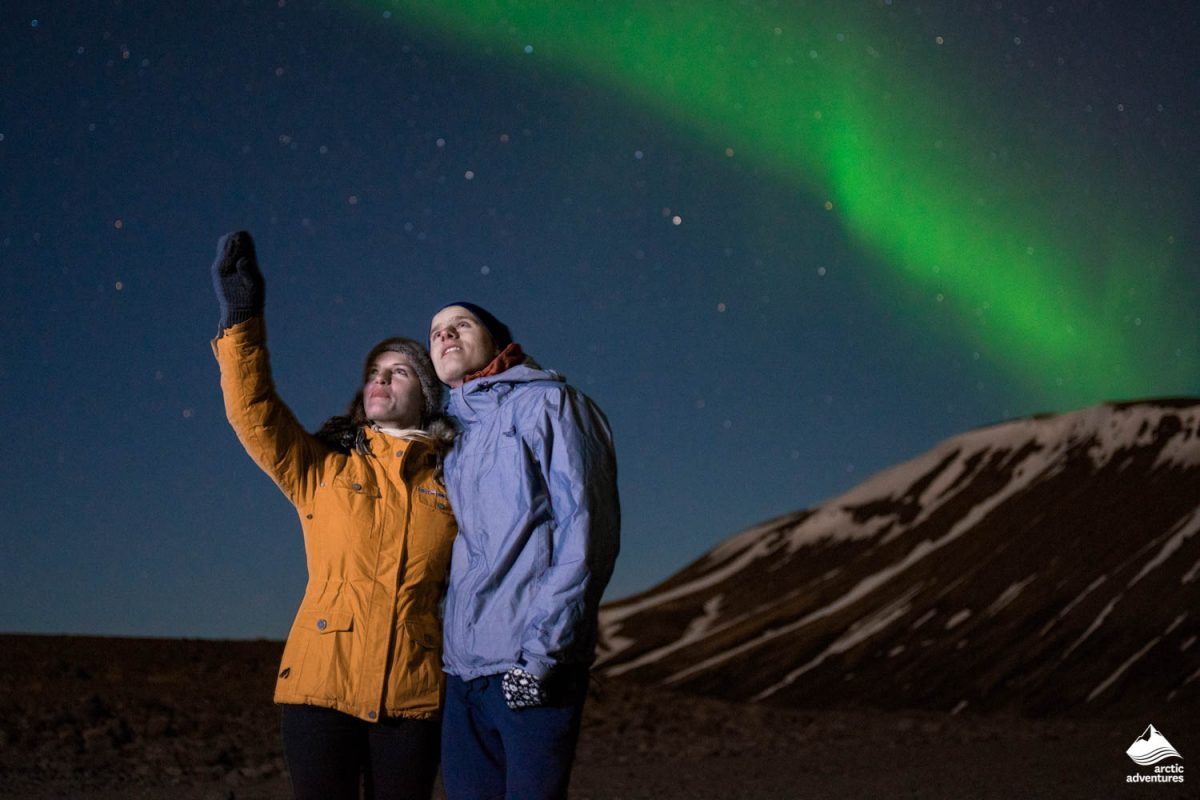 Couple looking at Northern Lights