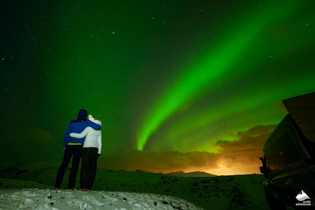 Couple observing Northern Lights