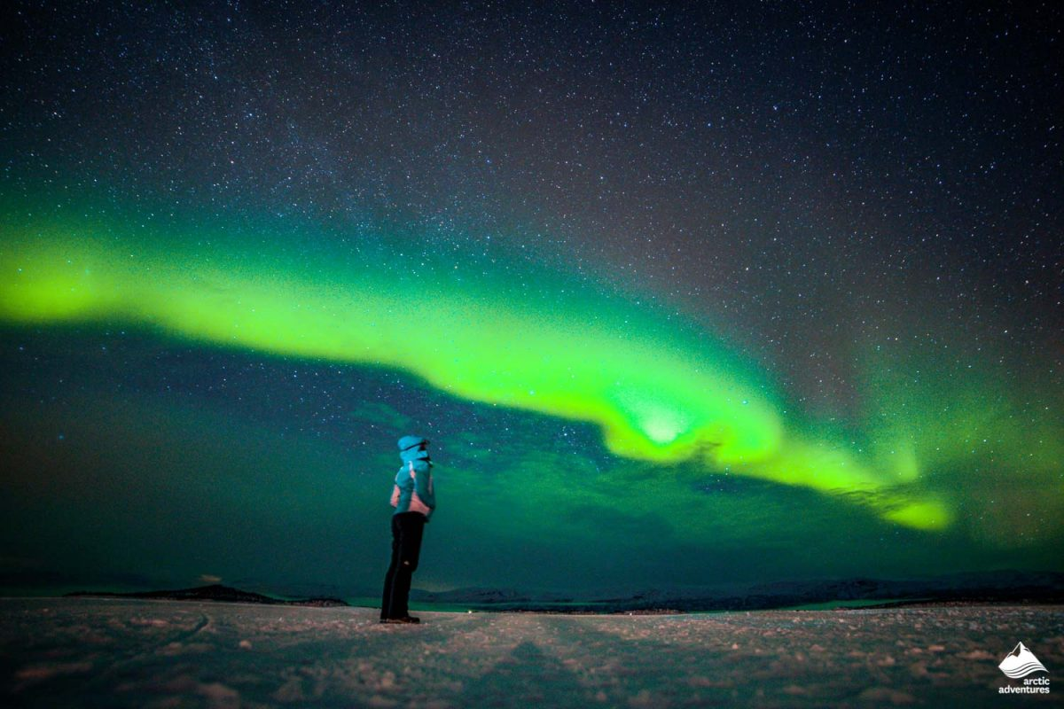 Girl watching the Northern Lights