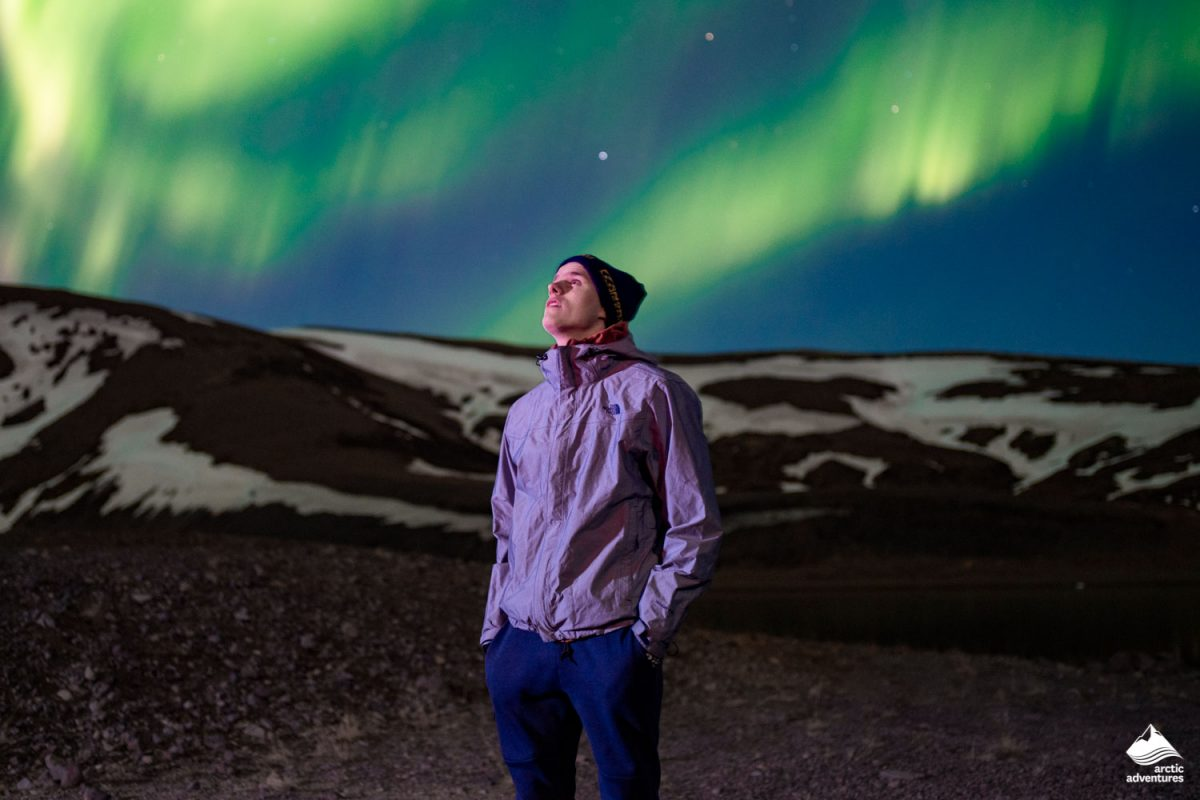 Man staring at Nnorthern Lights