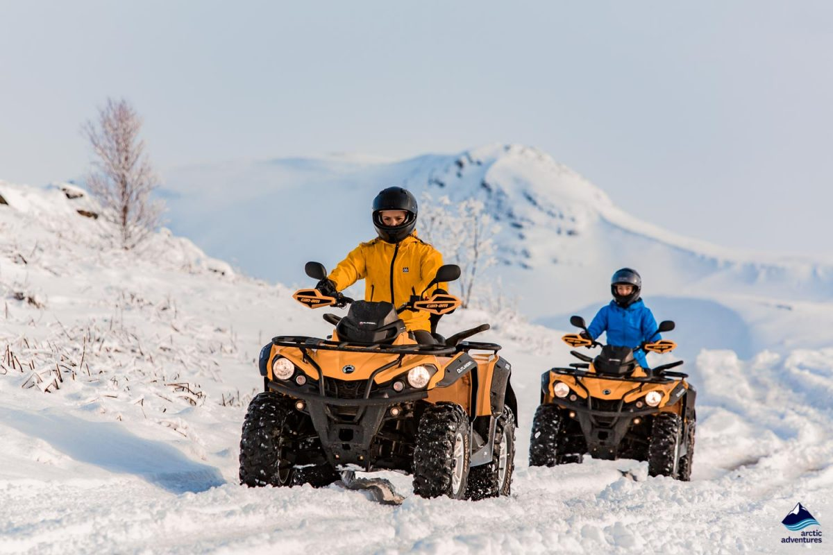 Couple on ATV in winter in Iceland