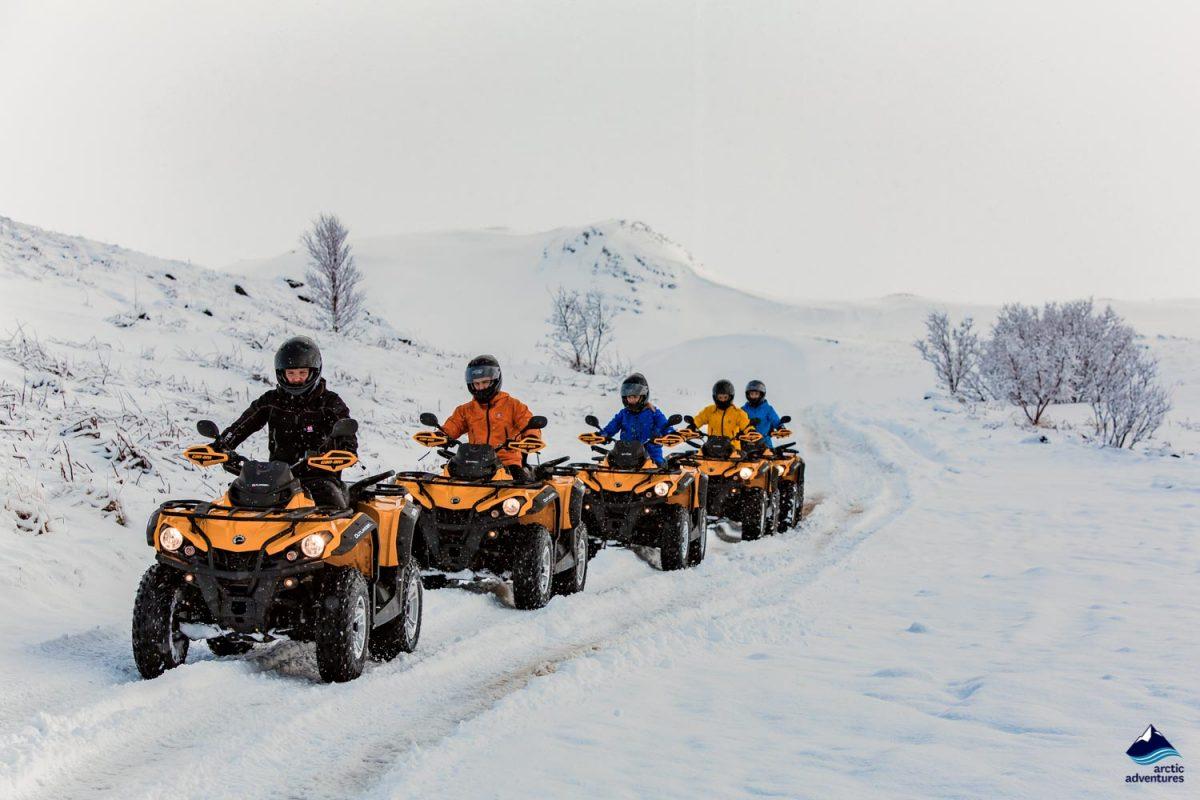 Man on ATV riding in winter