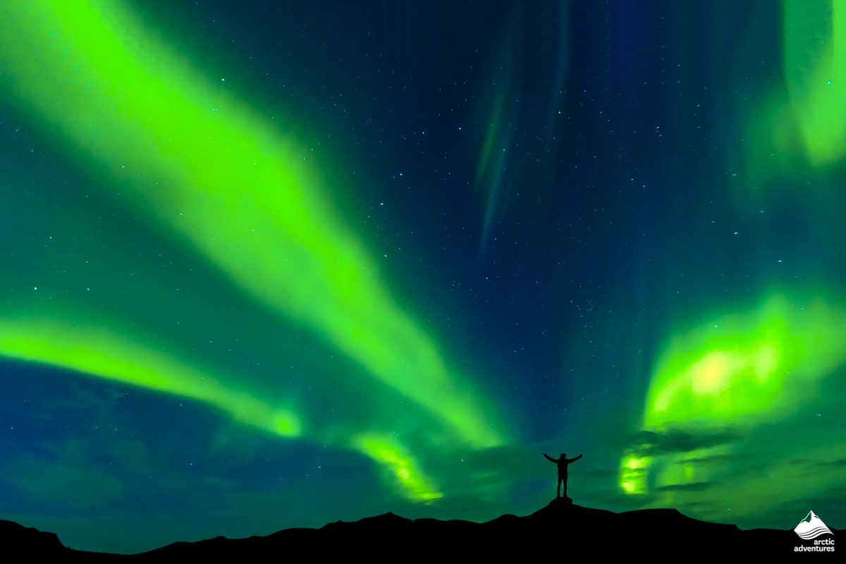 Northern Lights with silhouette standing man