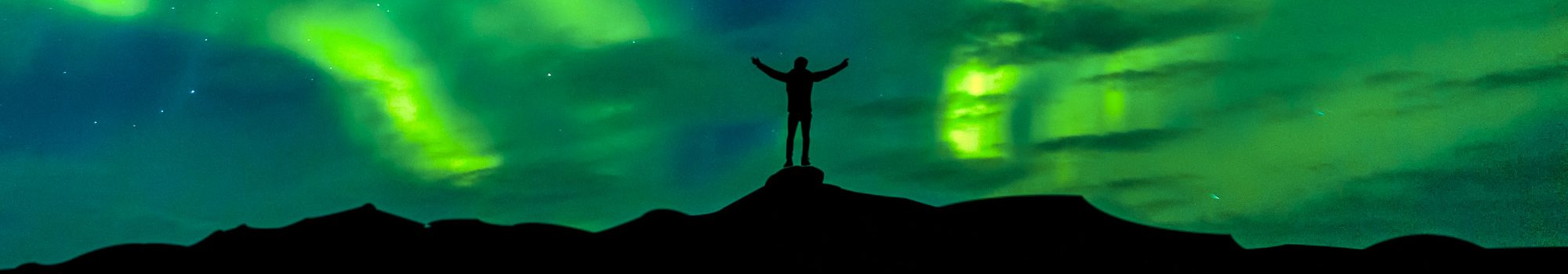 Aurora borealis with silhouette standing man