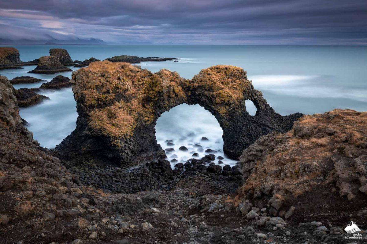 Volcanic cliffs and basalt rocks in Arnarstapi, Iceland