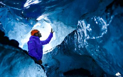man-blue-ice-cave-glacier-south-coast-iceland