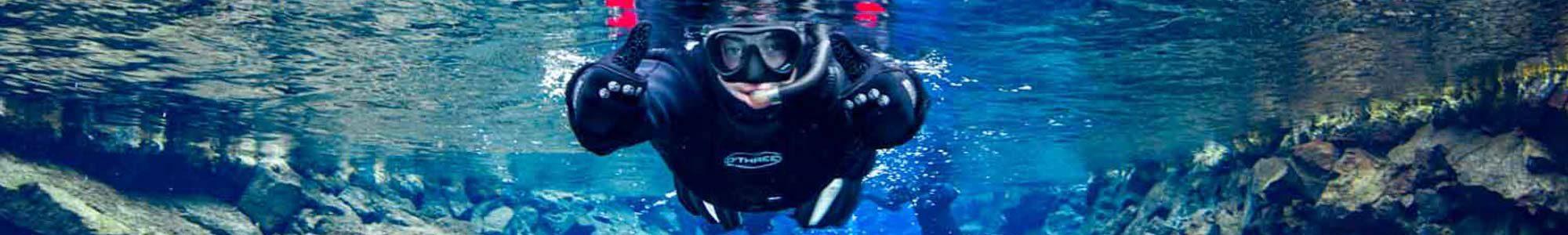 Girl snorkeling in SIlfra Fissure