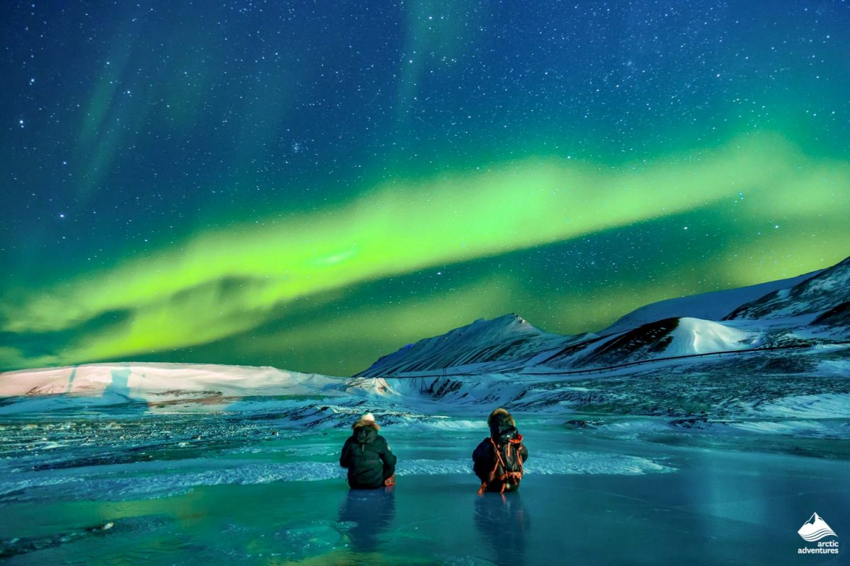 Two people looking for Northern Lights