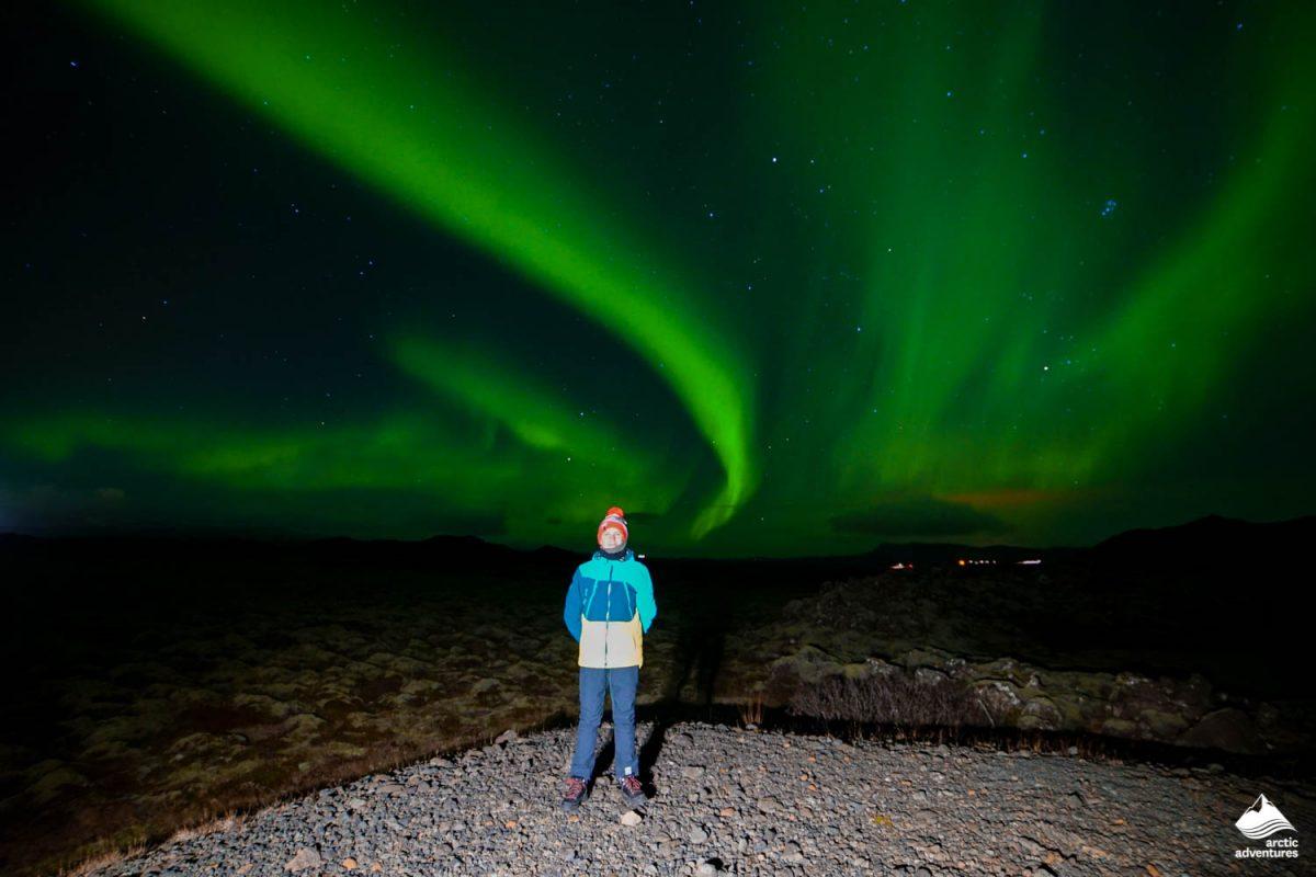 Man admiring Aurora Borealis