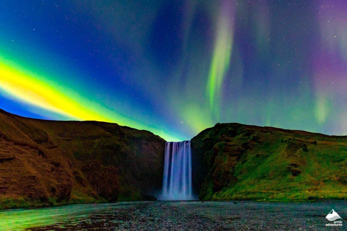 Northern Lights in front of Skogafoss Waterfall