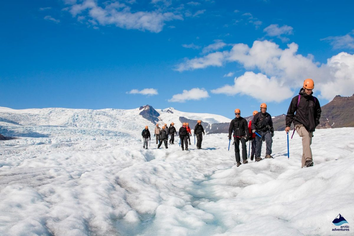 Group of people hiking on a glacier in Iceland