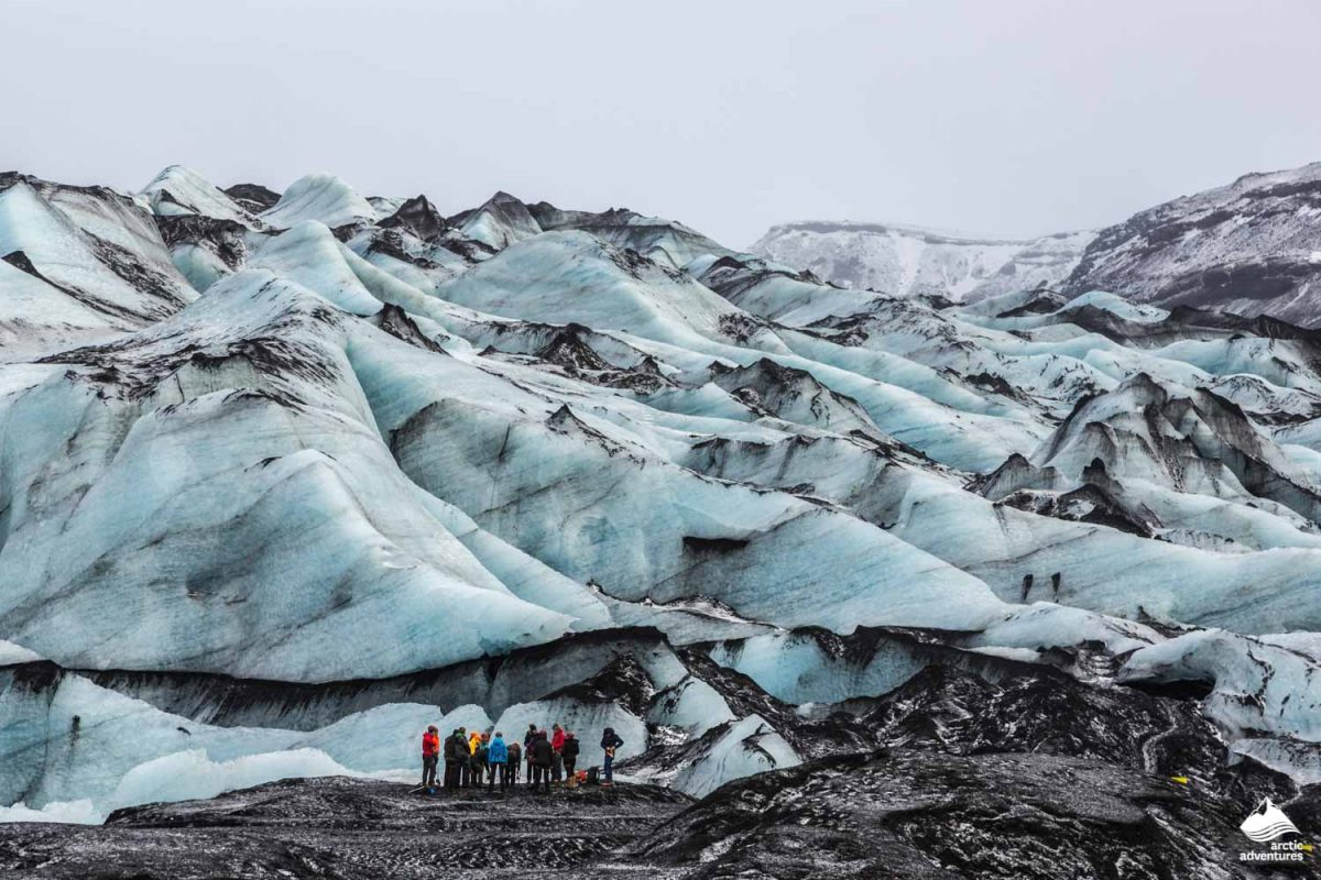 People hiking on Solheimajokull glacier