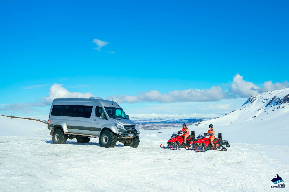 Super Jeep and snowmobilers on Langjokull glacier