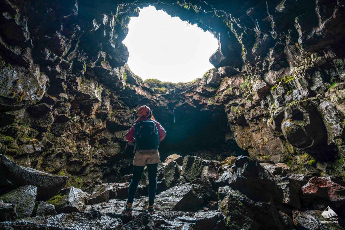 Woman in Raufarholshellir lava cave