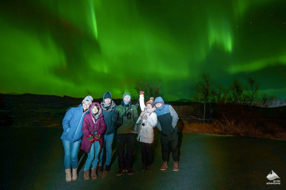 People staring at Northern Lights in Iceland