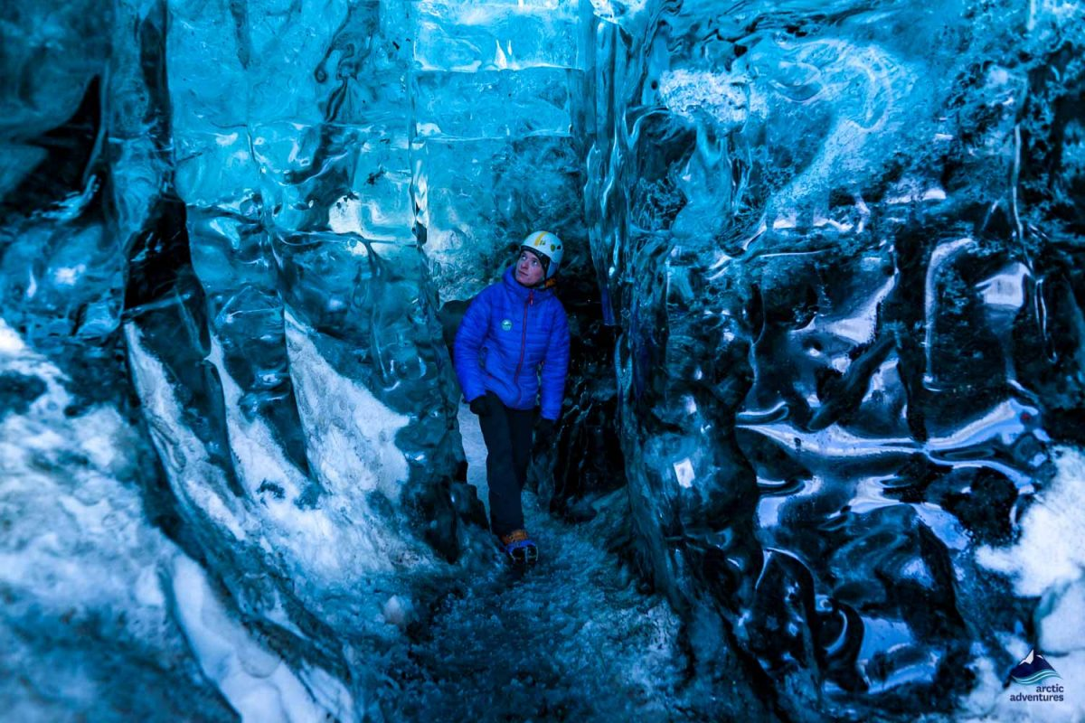 Man exploring natural ice cave in Iceland