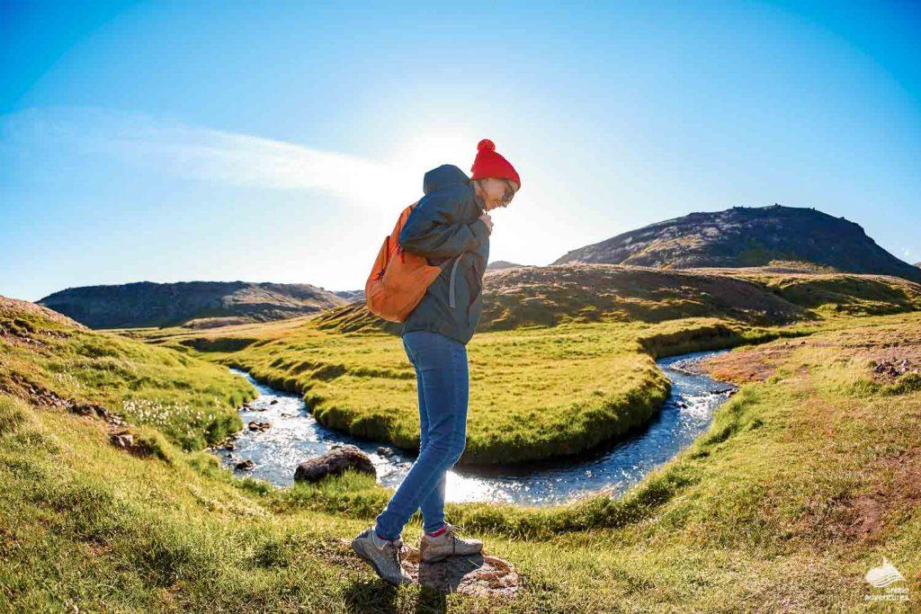 Girl hiking near Reykjadalur