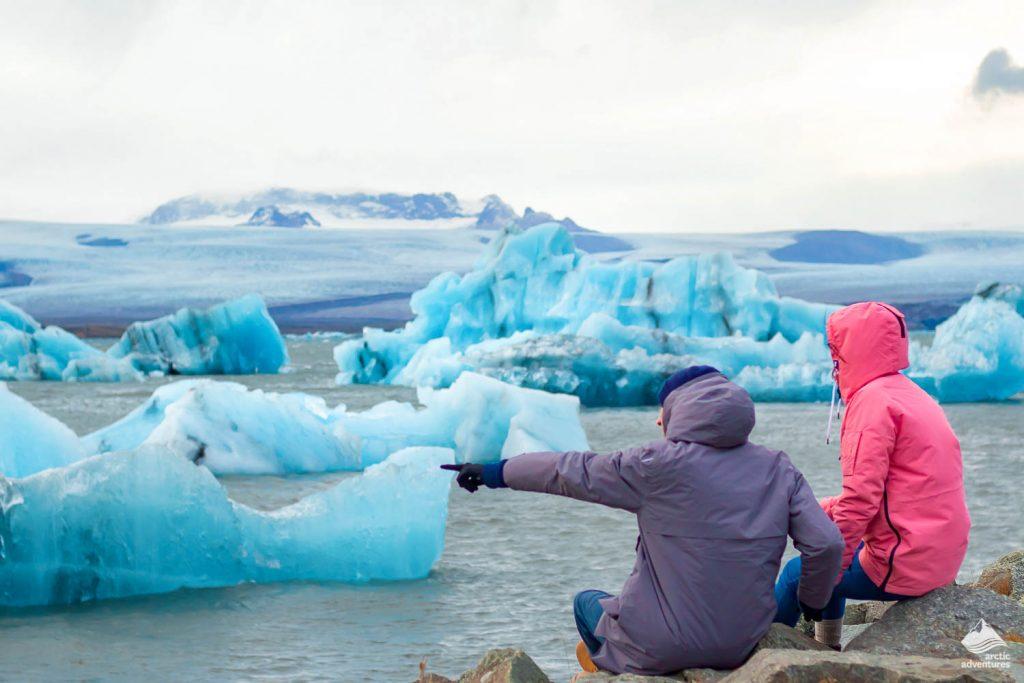 People staring at Jokulsarlon Glacial lake with icebergs