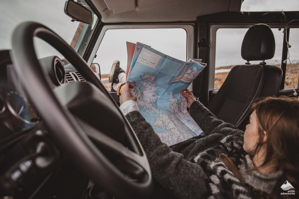 Woman looking at the map in a car