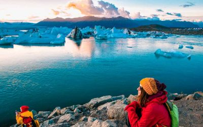 Woman in bright red sport jacket near the Glacier Lagoon