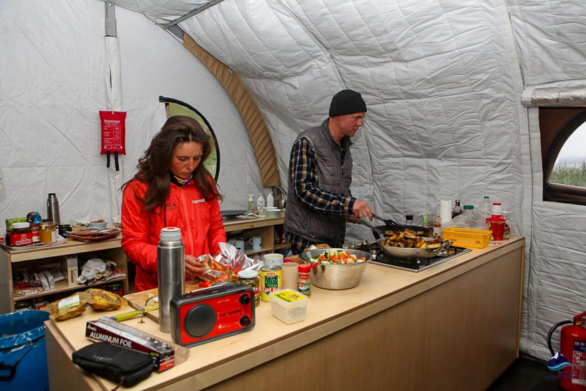 Cooking inside tent in Westfjords of Iceland