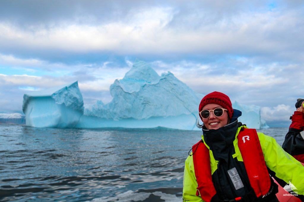 Tourist Near Floating Iceberg In Iceland