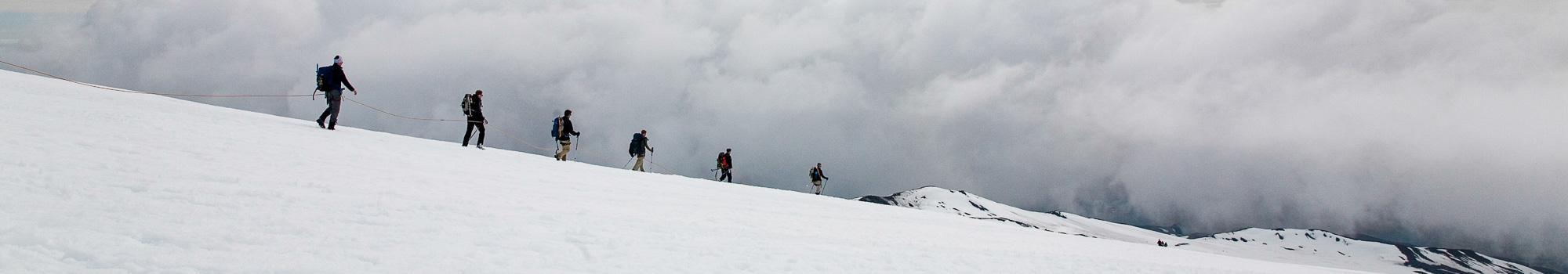 People on Hvannadalshnukur highest peak in Iceland