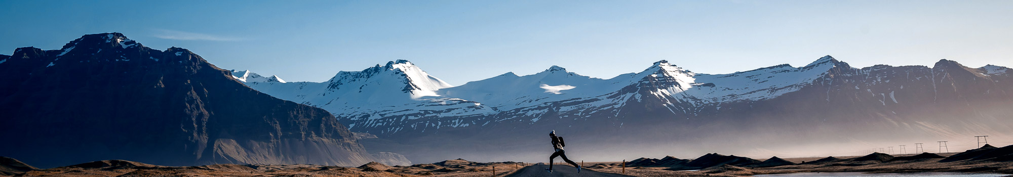 Man jumping on Winding mountain road