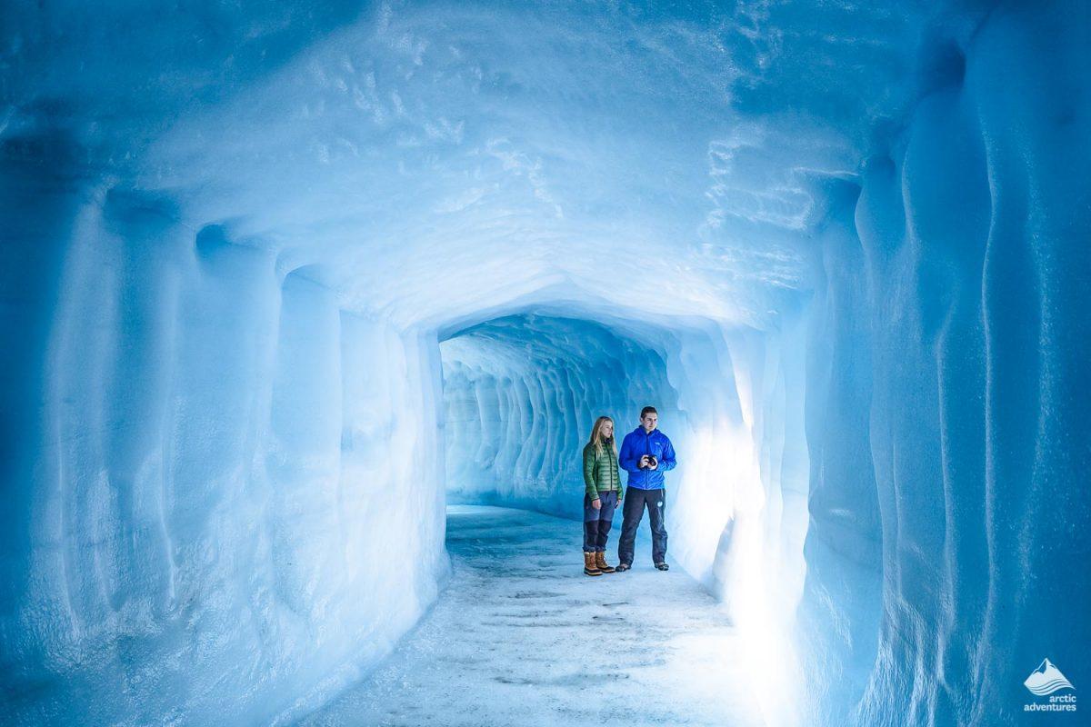 Couple inside man made ice cave in Langjokull Glacier