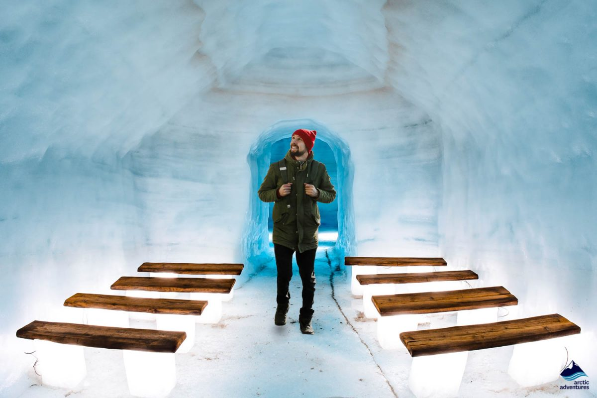 Man inside Into the Glacier ice cave in Iceland