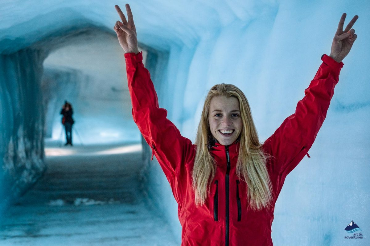 Happy woman inside the ice cave in Iceland