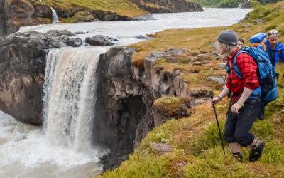 Hikers near waterfall in Iceland