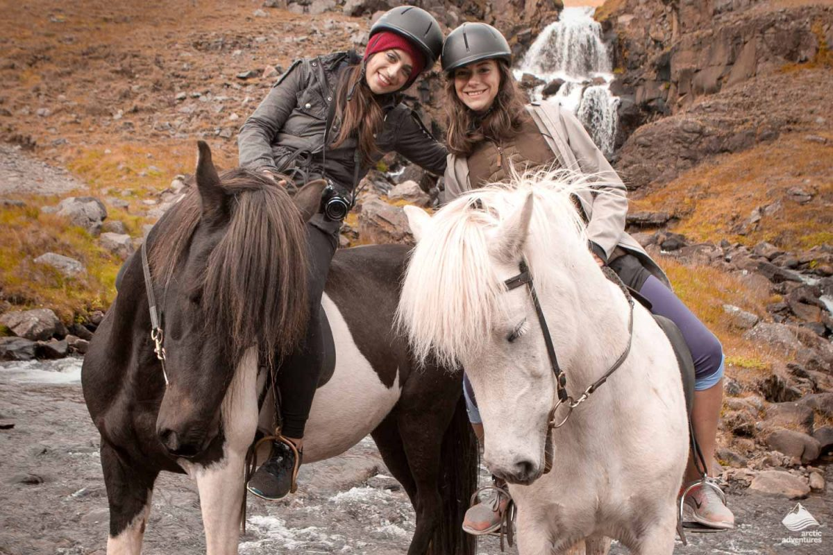 Photo of two girls riding an Icelandic horse