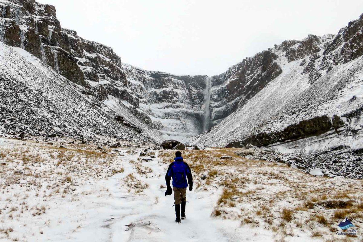 Man going towards Hengifoss waterfall