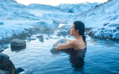 The girl bathes in the open air hot spring in Iceland