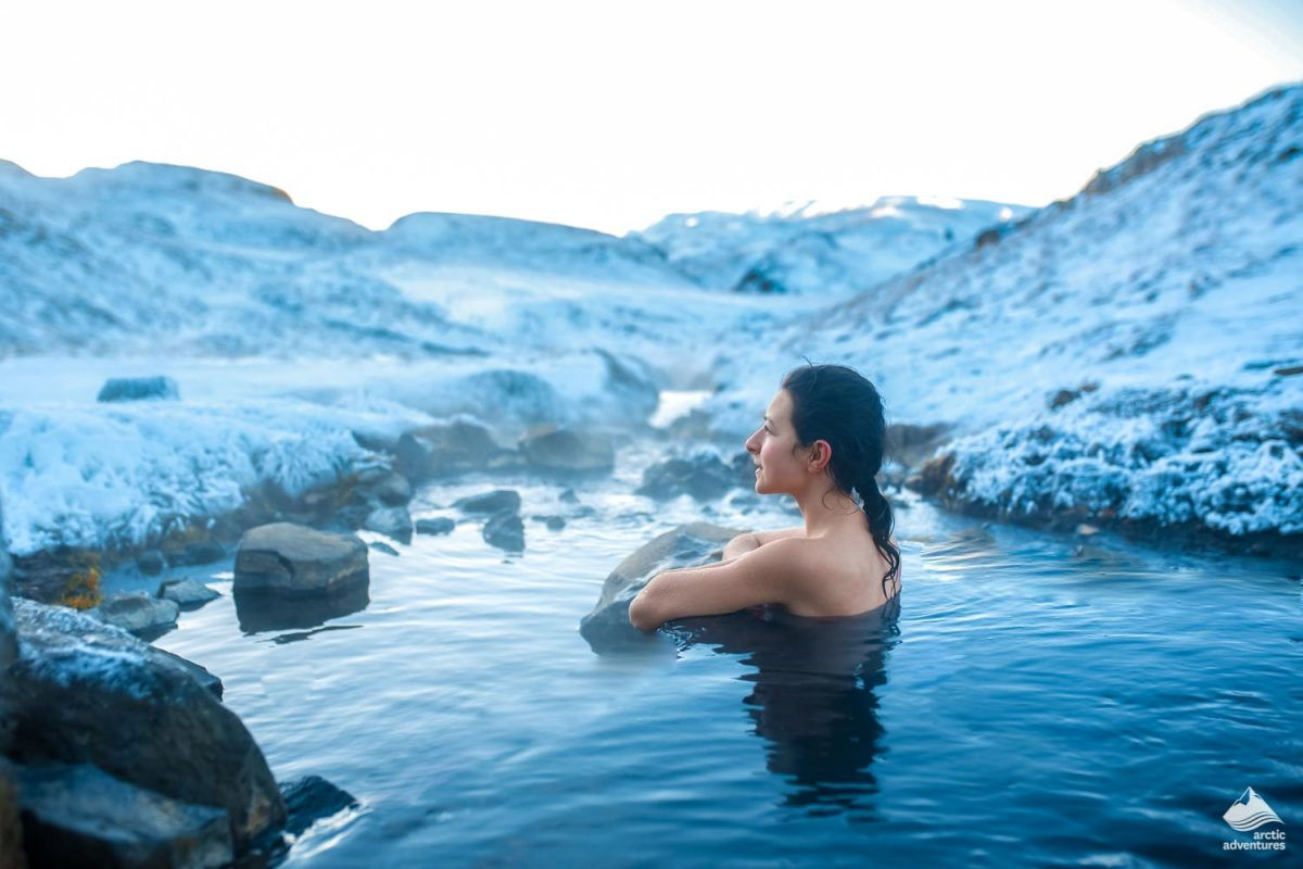 Woman relaxing in a hot spring in Iceland