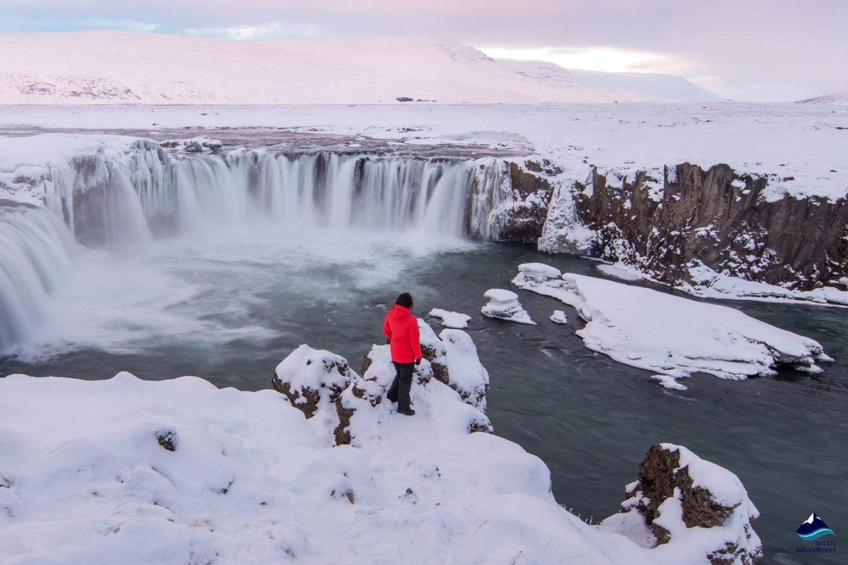 Woman standing near Godafoss waterfall